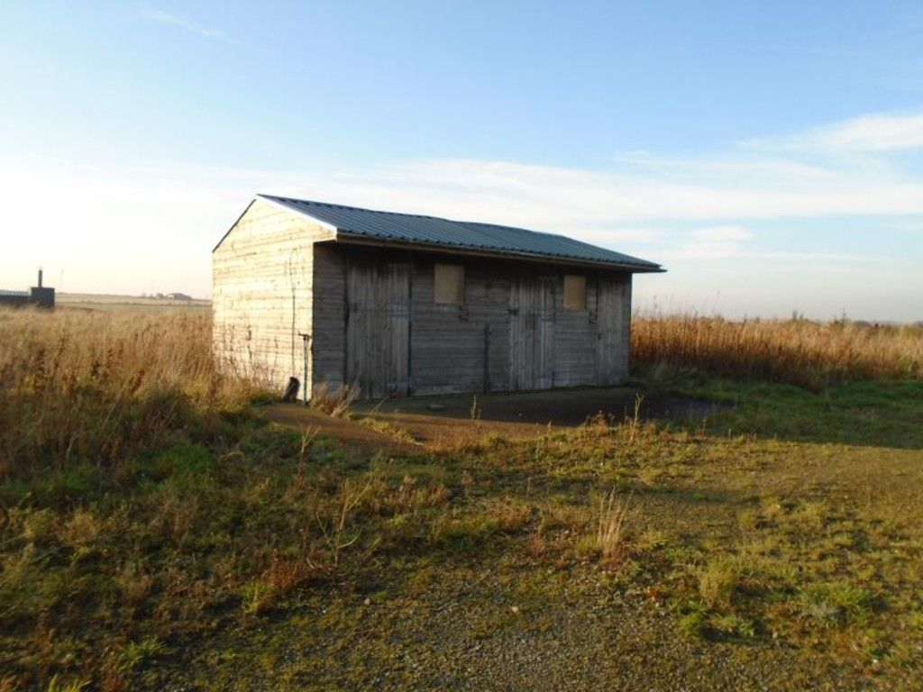 small shed in open field