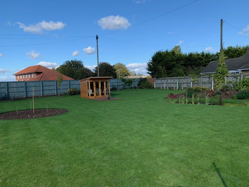 bungalow garden with a shed in it
