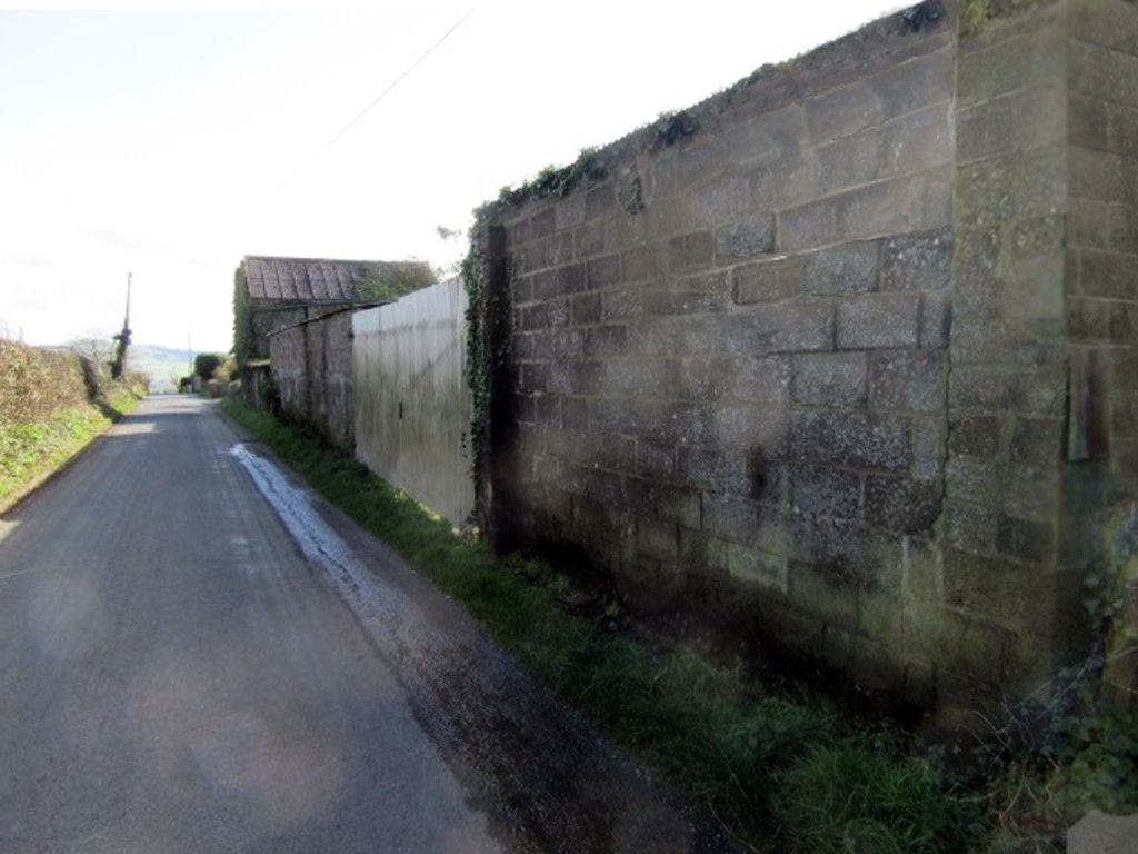 Stone wall outside rural house
