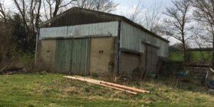 farm building in field