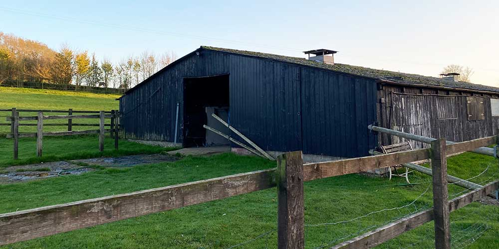 old agricultural building in field