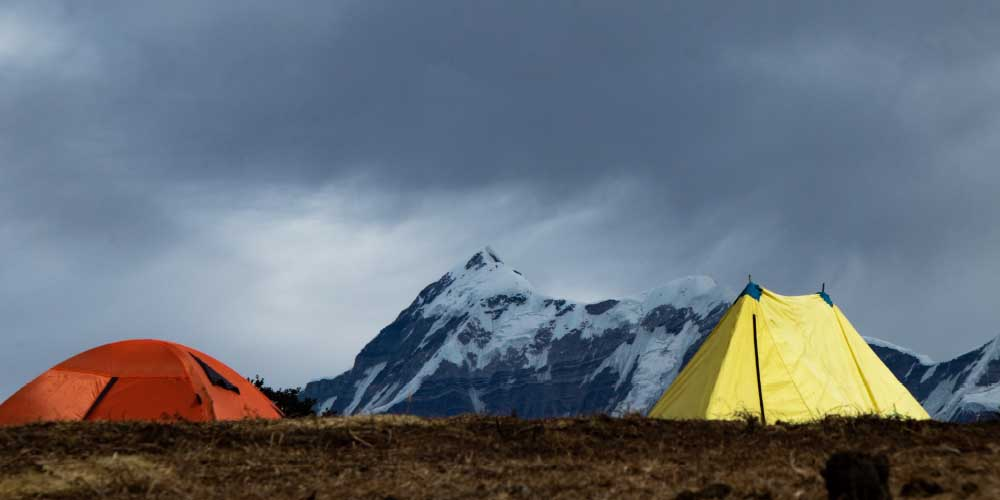 tents by mountain range